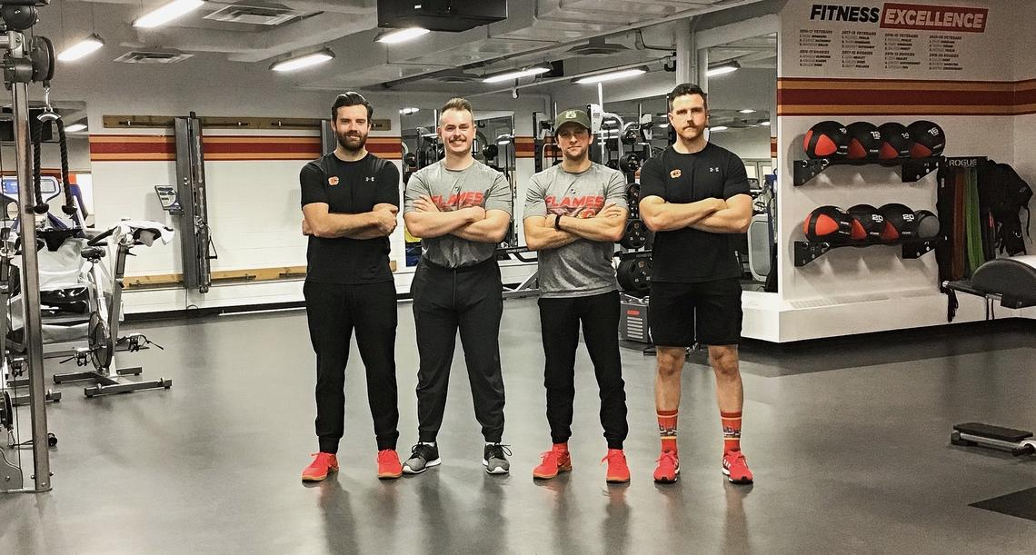 The Calgary Flames Strength and Conditioning Staff (S&C) for 2019-2020, from left: Caylin Relkoff, Daryl Chambers, Assistant S&C Alan Selby, and Head S&C Ryan Van Asten.
