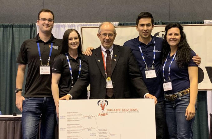 Gordon Atkins with UCVM students who were the first-ever Canadian team to win the AABP Quiz Bowl, from left: Brenden Hilgartner, Megan Dick, Nurmo Atabayev, and Rae-Leigh Pederzolli.