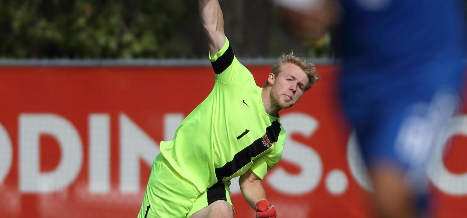 Soccer goaltender Jake Ruschkowski in action for the Dinos