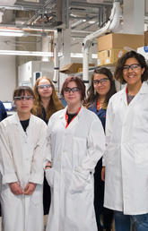 Grade 8 girls joined Ranjani Kannaiyan, second from left, in the lab as part of their day on the University of Calgary campus participating in Operation Minerva. Photo by Riley Brandt, University of Calgary