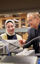 ASTech Award winner Dr. Fadhel Ghannouchi, PhD, works with a graduate student in the iRadio Lab at the Schulich School of Engineering